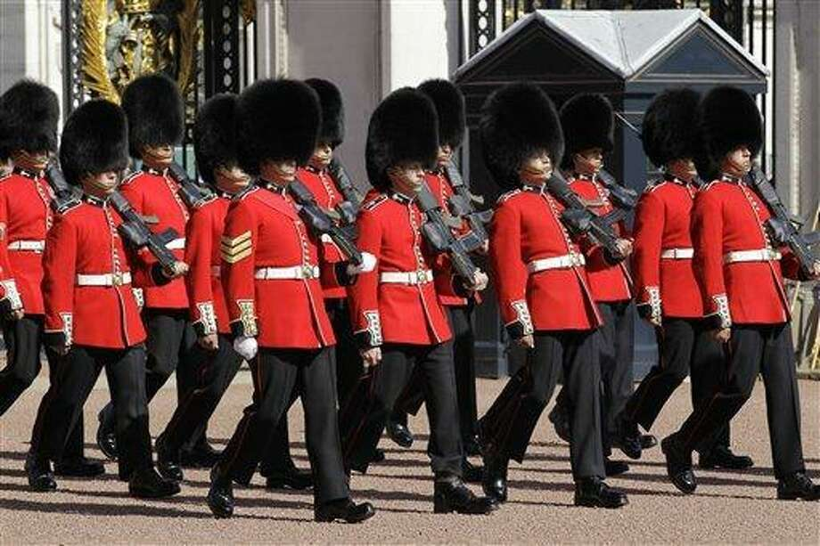 Welsh Guards perform their changing of guard ceremony at Buckingham Palace in London, Wednesday, April 6, 2011. Welsh Guards are to be the Guard of Honour for the returning of members of the royal family to Buckingham Palace from Westminster Abbey and will involve lining the route during the royal wedding of Prince William and Kate Middleton on April 29, 2011. (AP Photo/Sang Tan) Photo: AP / AP