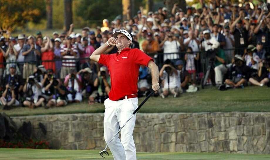 Keegan Bradley celebrates on the 18th green after winning a three-hole playoff against Jason Dufner at the PGA Championship golf tournament Sunday, Aug. 14, 2011, at the Atlanta Athletic Club in Johns Creek, Ga. (AP Photo/Matt Slocum) Photo: AP / AP