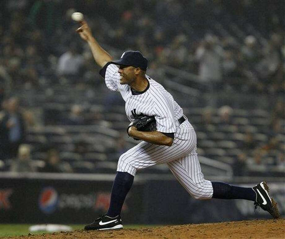 New York Yankees closer Mariano Rivera delivers in the ninth inning of the Yankees' 7-4 victory over the Baltimore Orioles in a baseball game at Yankee Stadium on Wednesday, April 13, 2011, in New York. (AP Photo/Kathy Willens) Photo: AP / AP