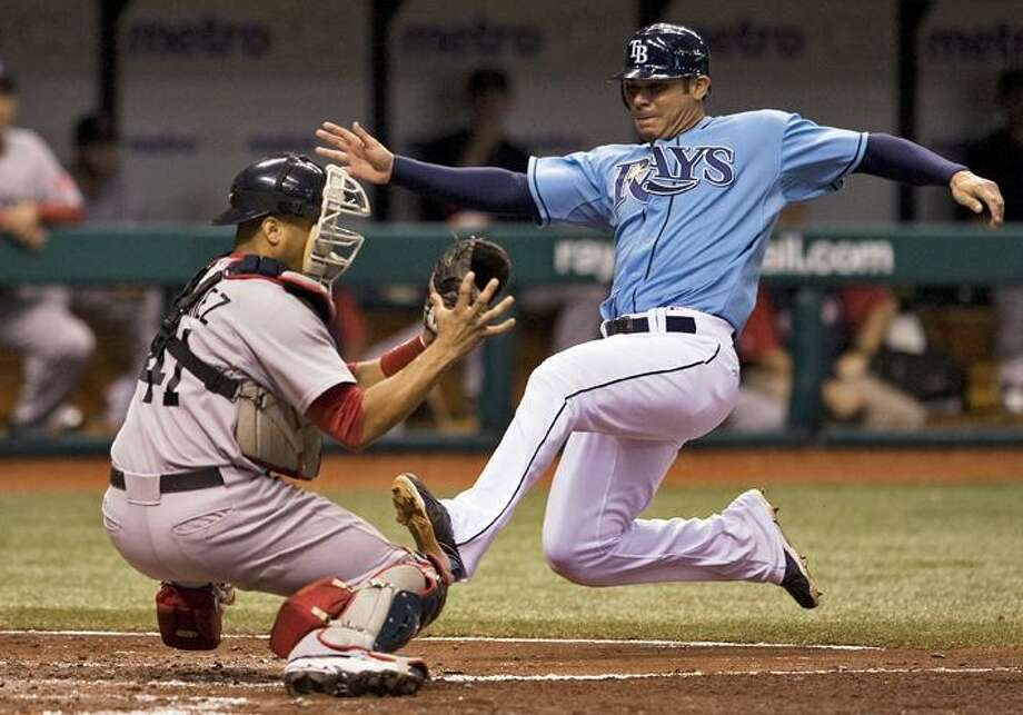 Boston Red Sox catcher Victor Martinez (41) blocks the plate as he tags out Tampa Bay Rays' Carlos Pena during the sixth inning of a baseball game Sunday in St. Petersburg, Fla. Pen was trying to score from second on Dan Johnson's single. The Red Sox lost 5-3. (AP Photo/Steve Nesius) Photo: AP / FR69810 AP