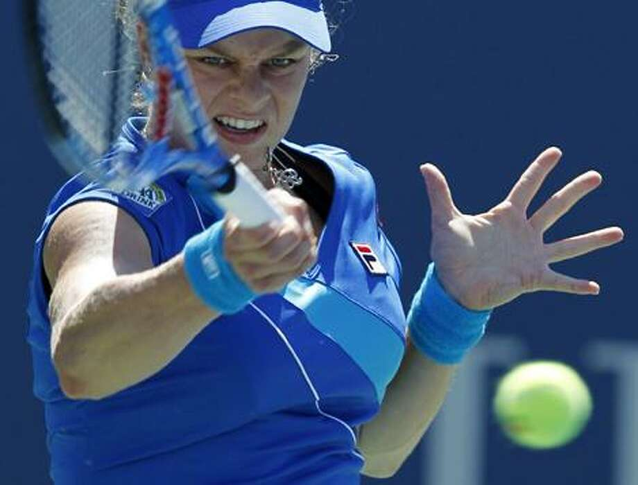 Kim Clijsters of Belgium returns a shot to Greta Arn of Hungary during the first round of the U.S. Open tennis tournament in New York, Monday. Clijsters won the match 6-0, 7-5. (AP Photo/Kathy Willens) Photo: AP / AP