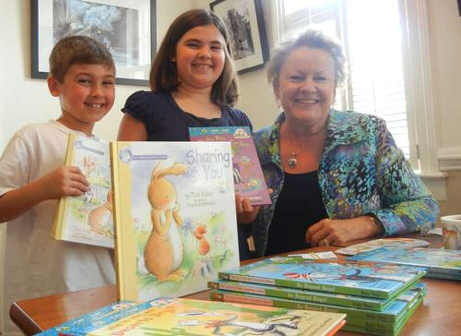 Author Tish Rabe is pictured with Jake and Brooke, brother and sister vacationing in Essex from Annapolis, Md. (Kelly Ann Gore-Oleksiw)