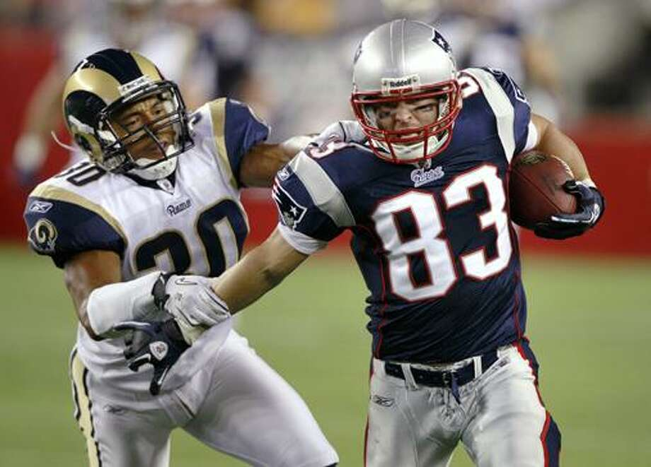 New England Patriots wide receiver Wes Welker, right, tries to get away form St. Louis Rams safety Kevin Payne during the second quarter of an NFL preseason football game Thursday in Foxborough, Mass. (AP Photo/Charles Krupa) Photo: AP / AP