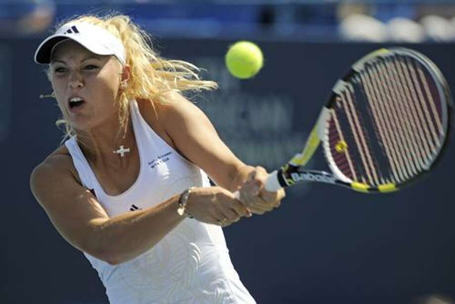 Caroline Wozniacki, of Denmark, hits a backhand during her 6-3, 3-6, 6-3, victory over Nadia Petrova, of Russia, in the women's final of the Pilot Pen tennis tournament in New Haven, Conn., on Saturday, Aug. 28, 2010. (AP Photo/Fred Beckham) Photo: AP / FR153656 AP