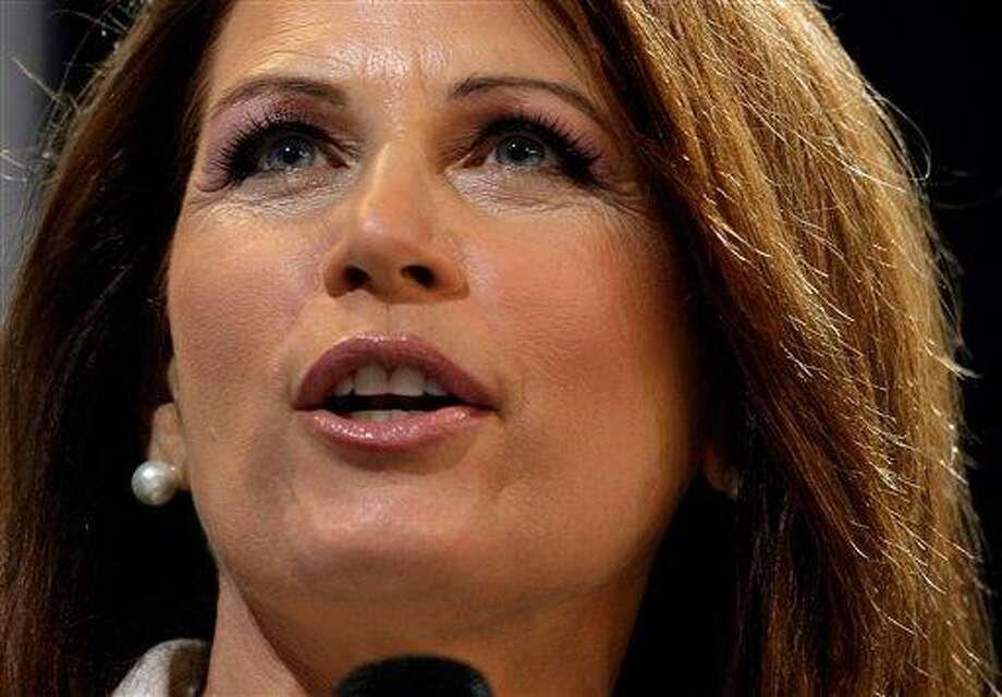 Republican presidential candidate Rep. Michele Bachmann, R-Minn.,  speaks during the Iowa Republican Party's Straw Poll, Saturday, Aug. 13, 2011, in Ames, Iowa.  Bachmann won the straw poll with 4823 votes. (AP Photo/Charlie Neibergall) Photo: AP / AP