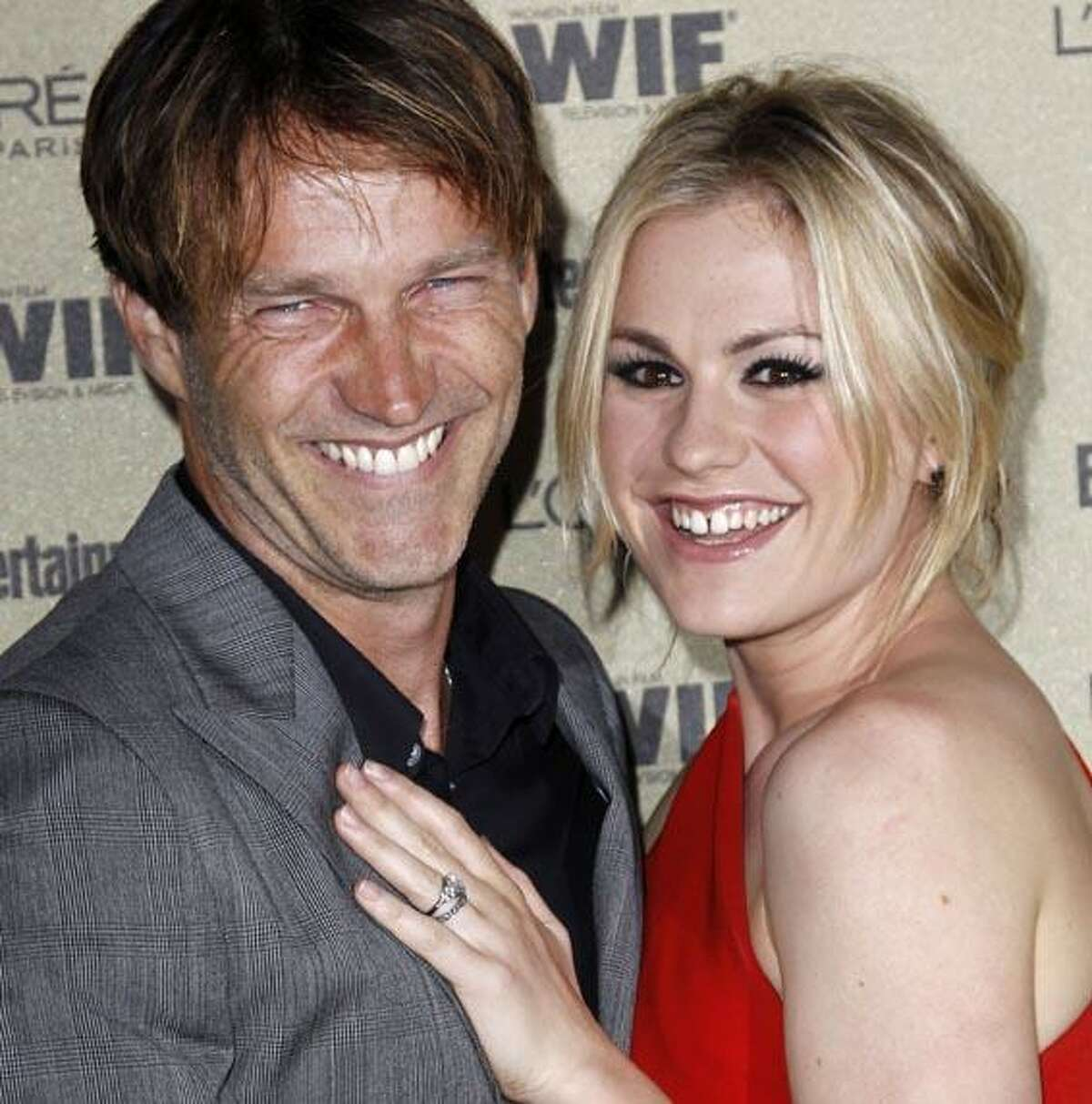 Anna Paquin, right, and Stephen Moyer arrive at the Entertainment Weekly and Women in Film Pre-Emmy Party in West Hollywood, Calif. on Friday, Aug. 27, 2010. (AP Photo/Matt Sayles)