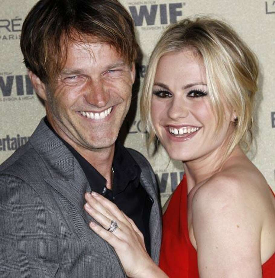 Anna Paquin, right, and Stephen Moyer arrive at the Entertainment Weekly and Women in Film Pre-Emmy Party in West Hollywood, Calif. on Friday, Aug. 27, 2010. (AP Photo/Matt Sayles) Photo: AP / AP