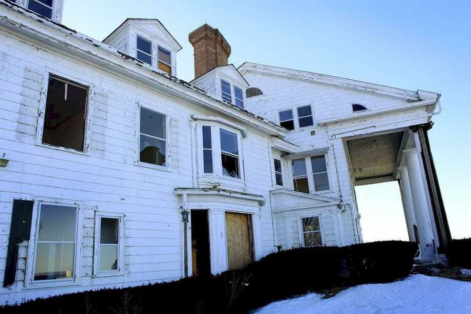 "This Tuesday, March 29, 2011 photo shows the rear of the ""Land's End"" estate in Sands Point, Long Island, N.Y. The 25-room mansion that some scholars believe inspired F. Scott Fitzgerald's ""The Great Gatsby"" is being razed for a subdivision of five houses priced at $10 million each. (AP Photo/Newsday, John Dunn) Photo: ASSOCIATED PRESS / AP2011"