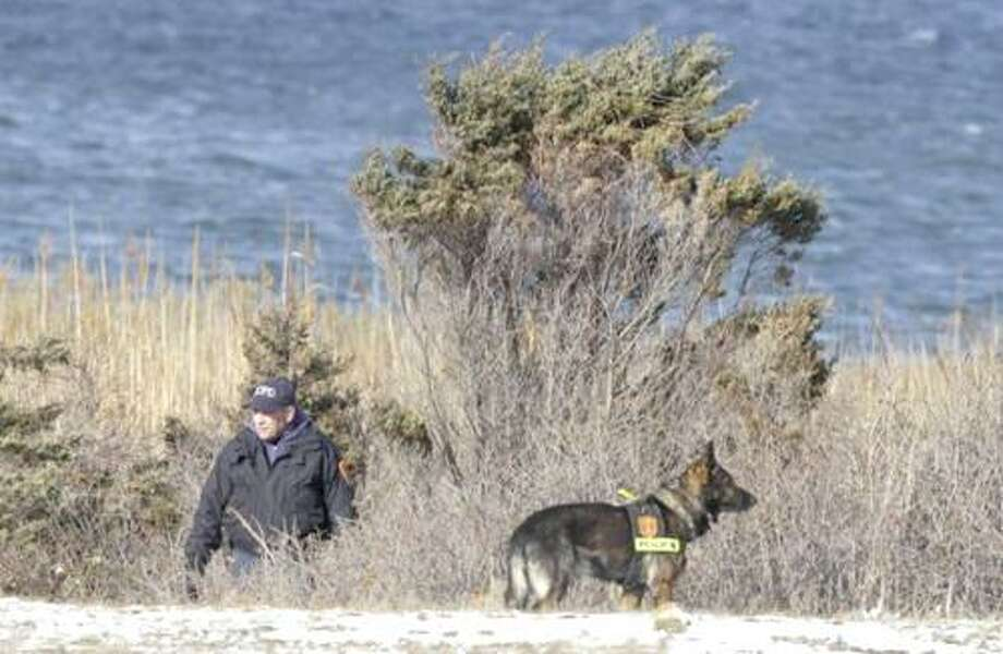 AP photo/Police search the site where the badly decomposed remains of women were found on a L.I. beach.