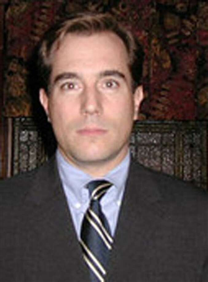 In this undated photograph provided by Security Traders Association of New York, Mark Madoff is shown. Mark Madoff, one of Bernard Madoff's sons, was found dead of an apparent suicide Saturday, Dec. 11, 2010 on the second anniversary of his father's arrest, according to a law enforcement official.  Mark Madoff, 46, was found hanged in his apartment in Manhattan's fashionable SoHo section, according to the official. A family member notified police around 7:30 a.m. (AP Photo/Security Traders Association of New York, Kimberly Unger) NO SALES Photo: ASSOCIATED PRESS / AP2010