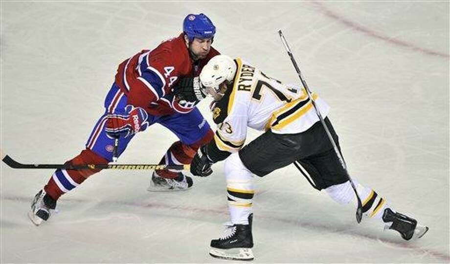 Boston Bruins' Michael Ryder is stopped by Montreal Canadiens defenseman Roman Hamrlik during the third period of Game 3 of an NHL hockey Stanley Cup playoffs first-round series, Monday, April 18, 2011, in Montreal. Boston won 4-2. (AP Photo/The Canadian Press, Paul Chiasson) Photo: AP / The Canadian Press