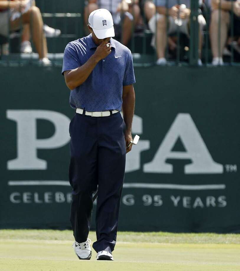 ASSOCIATED PRESS Tiger Woods reacts after missing a birdie putt on the sixth hole during the second round of the PGA Championship golf tournament Friday at the Atlanta Athletic Club in Johns Creek, Ga.