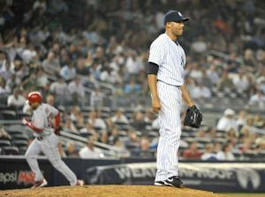 ASSOCIATED PRESS New York Yankees' Mariano Rivera stands on the mound as Los Angeles Angels' Bobby Abreu rounds third base after hitting a two-run home run in the ninth inning of Tuesday's game at Yankee Stadium in New York. Rivera is not worried in spite of his recent struggles on the mound.
