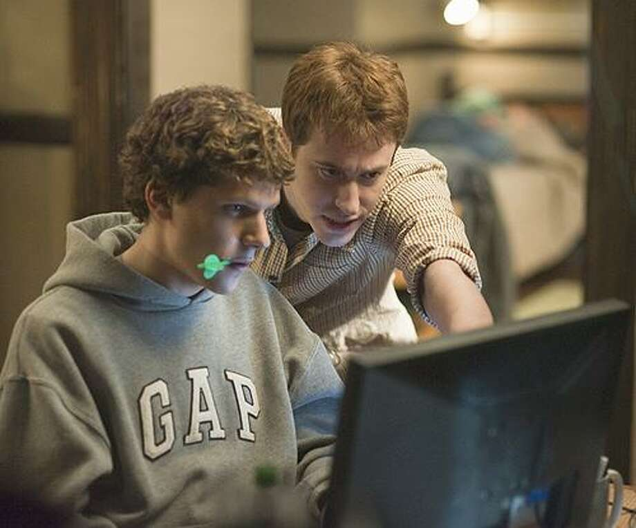 """In this publicity image released by Columbia Pictures, Jesse Eisenberg, left, and Joseph Mazzello are shown in a scene from """"The Social Network.""""  The American Film Institute named the movie as one of the year's 10 most outstanding films Sunday, Dec. 12, 2010. (AP Photo/Columbia Pictures, Merrick Morton) NO SALES Photo: ASSOCIATED PRESS / AP2009"""