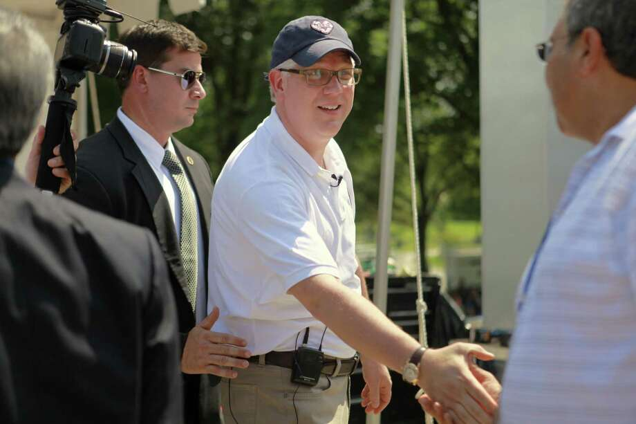 Glenn Beck, center, shakes hands with supporters at the site of the Restoring Honor rally by the Lincoln Memorial in Washington, on Friday, Aug. 27, 2010.  The rally will take place on Saturday. (AP Photo/Jacquelyn Martin) Photo: ASSOCIATED PRESS / AP