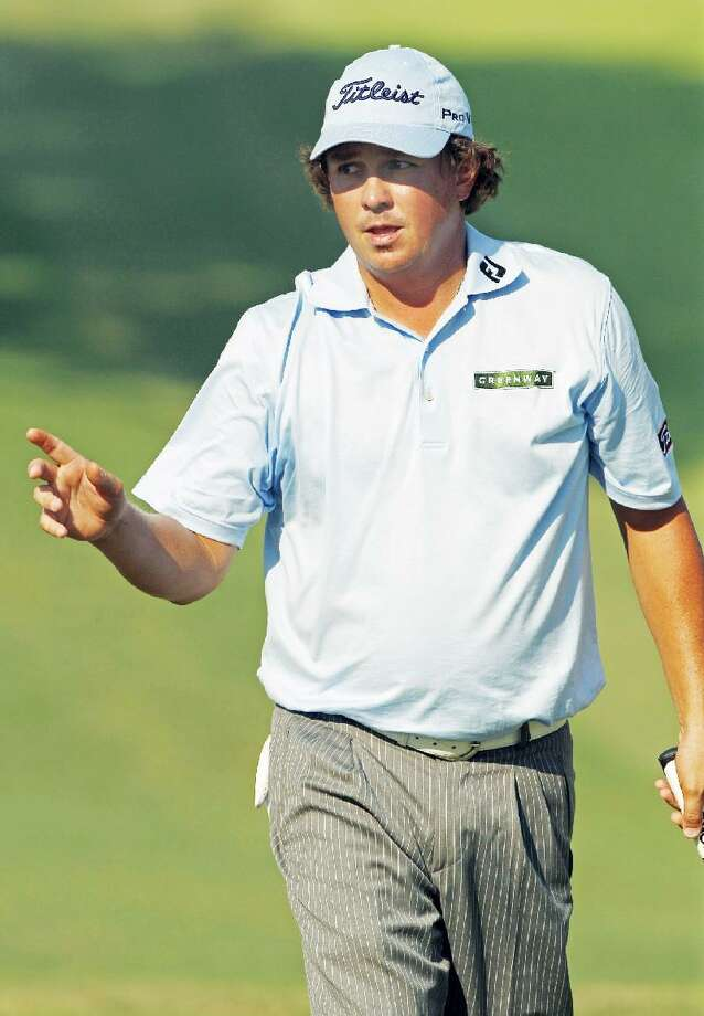 ASSOCIATED PRESS Jason Dufner reacts after making a birdie putt on the ninth hole during the second round of the PGA Championship golf tournament Friday at the Atlanta Athletic Club in Johns Creek, Ga.
