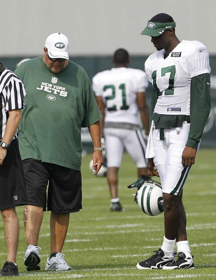 ASSOCIATED PRESS New York Jets head coach Rex Ryan, left, talks to wide receiver Plaxico Burress during training camp on Aug. 7 at Atlantic Health Training Center in Florham Park, N.J.