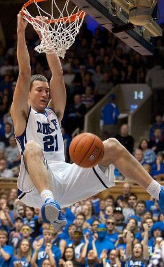 AP Duke's Miles Plumlee dunks the ball during the first half of Saturday's game against Saint Louis in Durham, N.C. Duke won 84-47. The Blue Devils are once again the unanimous No. 1 in the AP poll.