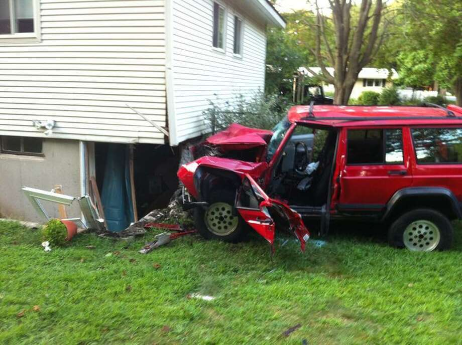 Police say the woman driving this car slammed into a house on Maple Avenue in Old Saybrook Wednesday. She was extricated from the vehicle and taken by helicopter to Yale-New Haven Hospital.