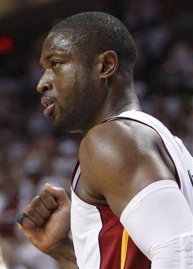 Miami Heat's Dwyane Wade celebrates after scoring during the second half of Game 1 of a first-round NBA playoff basketball series against the Philadelphia 76ers, Saturday, April 16, 2011 in Miami. The Heat defeated the 76ers 97-89. (AP Photo/Wilfredo Lee) Photo: ASSOCIATED PRESS / AP2011