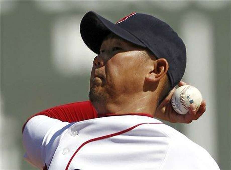 Boston Red Sox starting pitcher Daisuke Matsuzaka of Japan winds up against the Toronto Blue Jays during the first inning of a MLB baseball game at Fenway Park in Boston Monday, April 18, 2011. (AP Photo/Winslow Townson) Photo: ASSOCIATED PRESS / AP2011