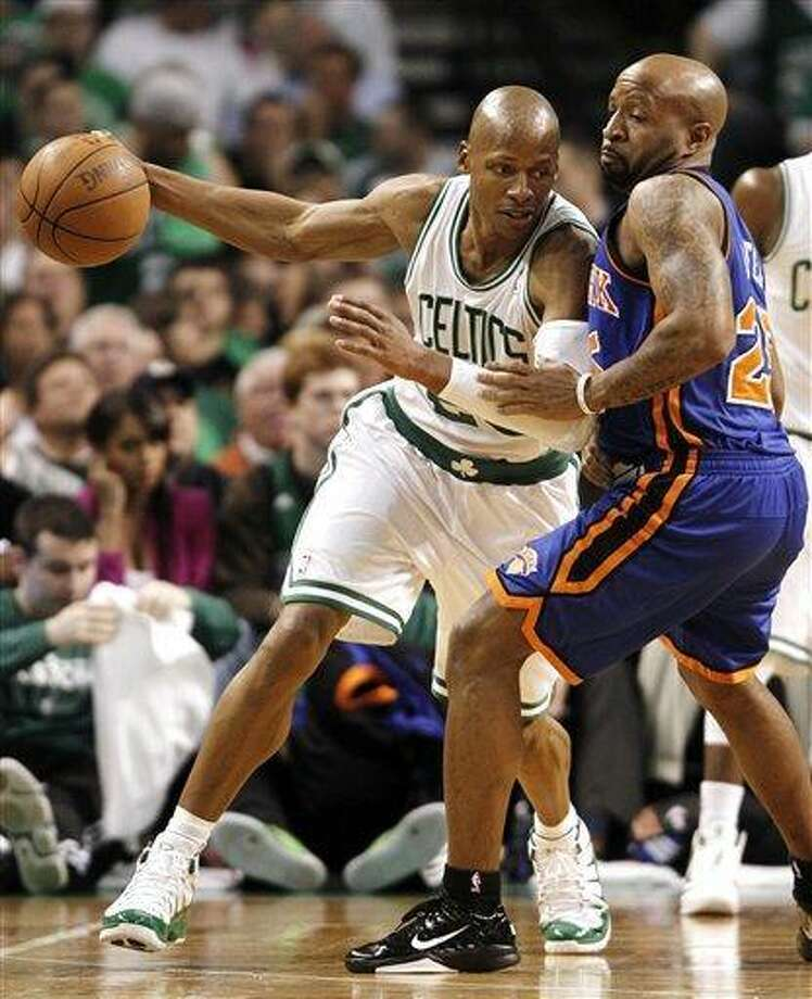 Boston Celtics' Ray Allen works on New York Knicks' Toney Douglas during the fourth quarter of Boston's 87-85 win in Game 1 of a first-round NBA playoff basketball series in Boston on Sunday, April 17, 2011. (AP Photo/Winslow Townson) Photo: ASSOCIATED PRESS / AP2011