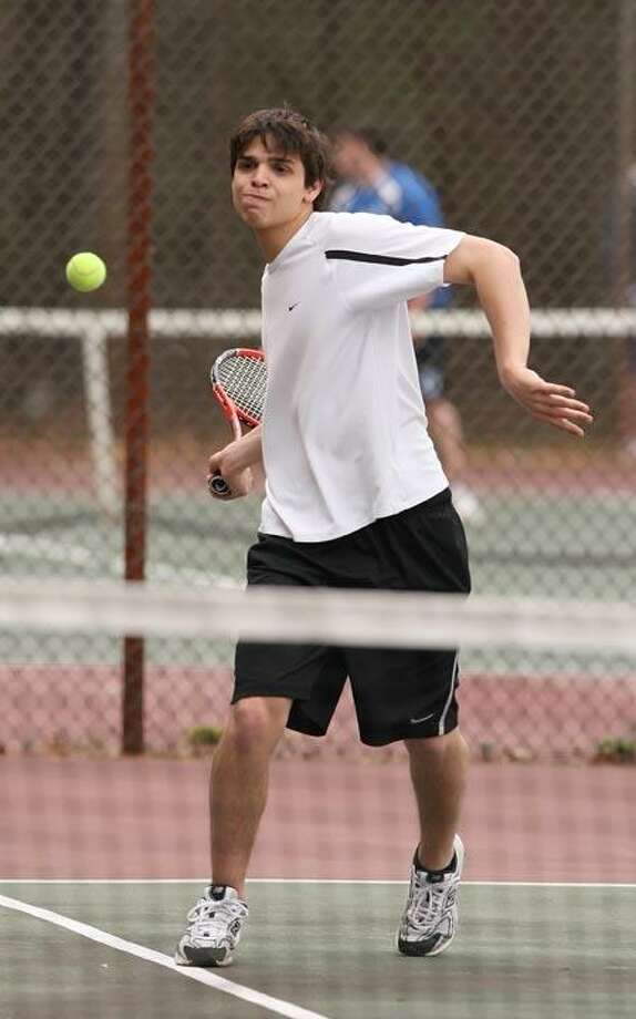 Todd Kalif/Special to The Press Devin McManus powers a forehand on his way to the net in Xavier boys' tennis 6-1 win over West Haven on Monday.