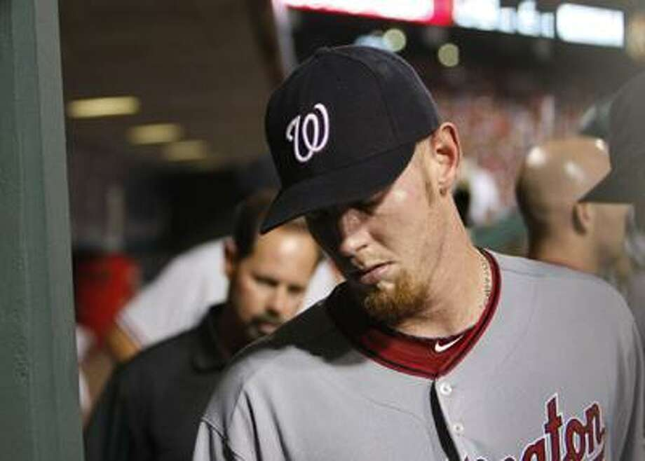 Washington Nationals pitcher Stephen Strasburg heads to the clubhouse through the dugout after leaving the fifth inning of a baseball game against the Philadelphia Phillies on Saturday, Aug. 21. (AP) Photo: ASSOCIATED PRESS / Philadelphia Inquirer