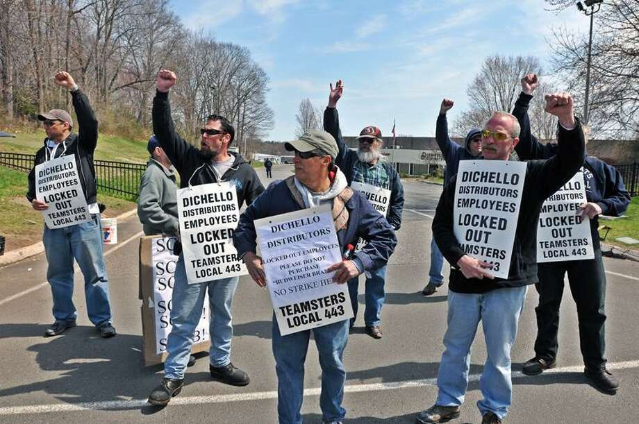 Locked out workers at Dichello Distributors in Orange picket over stalled contract negoations. (Peter Casolino/Register)