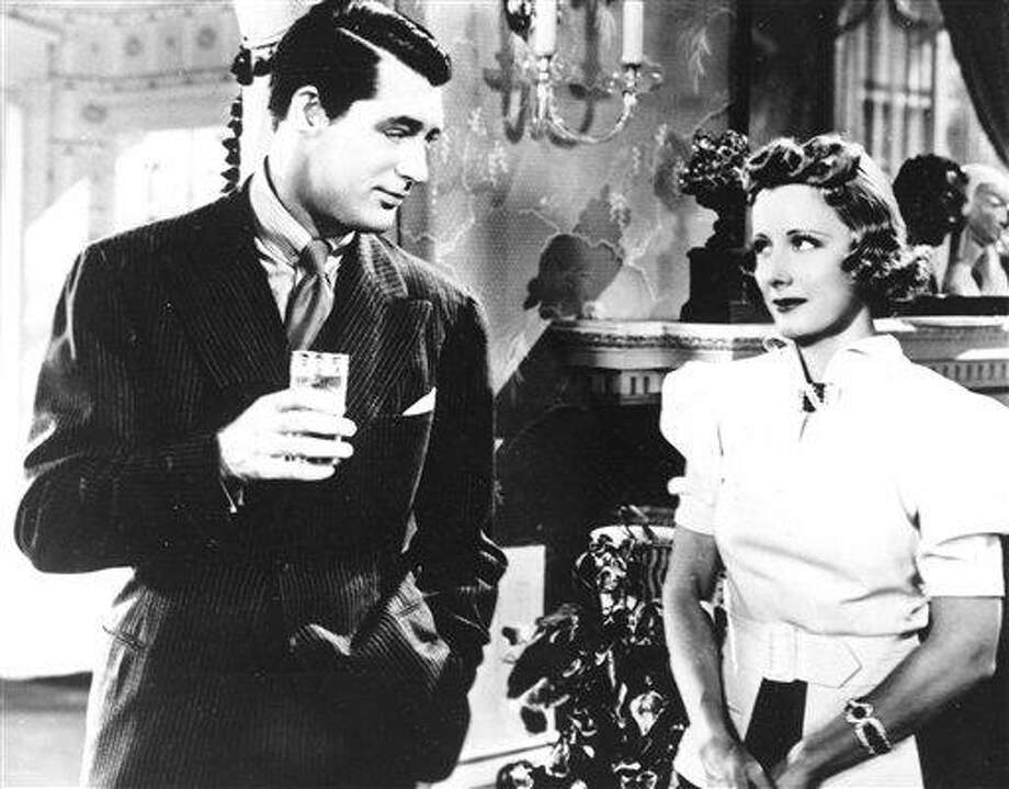 "In this 1937 file photo originally released by Columbia Pictures, actor Cary Grant, left, and actress Irene Dunne are shown in a scene of the motion picture ""The Awful Truth."" (AP Photo/Columbia Pictures, File) Photo: AP / Columbia Pictures"