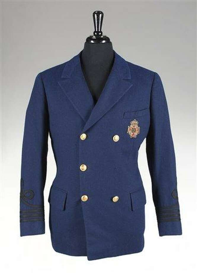 "This undated image provided by Julien's Auctions shows a double-breasted navy wool blazer worn by Tony Curtis in his role as Joe in the famous shipboard kissing scene with Marilyn Monroe in ""Some Like it Hot."" Paintings, sculptures and other collectibles that once belonged to Tony Curtis are scheduled to be auctioned on Sept. 17 at Julien's Auctions in Los Angeles. (AP Photo/Julien's Auctions) Photo: AP / Julien's Auctions"