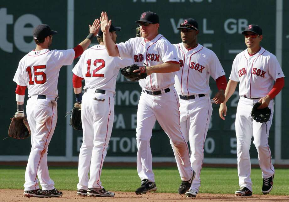 AP Boston Red Sox's J.D. Drew, center, celebrates with teammates, from left, Dustin Pedroia, Jed Lowrie, Carl Crawford and Jacoby Ellsbury after beating the Toronto Blue Jays 8-1 in the ninth inning of a major league baseball game, Sunday in Boston.