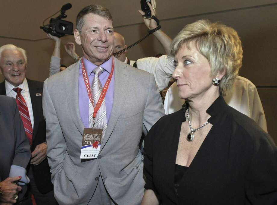 In this May 21, 2010 file photo, Republican candidate for U.S. Senate Linda McMahon, right, and husband Vince McMahon, left, wait for delegate totals to be tallied during the Connecticut Republican Convention in Hartford, Conn. Vince McMahon, chairman and CEO of World Wrestling Entertainment, says his wife's political opponents are taking unfair shots at his business to try to discredit her U.S. Senate candidacy. (AP Photo/Jessica Hill, File) Photo: ASSOCIATED PRESS / FR125654 AP