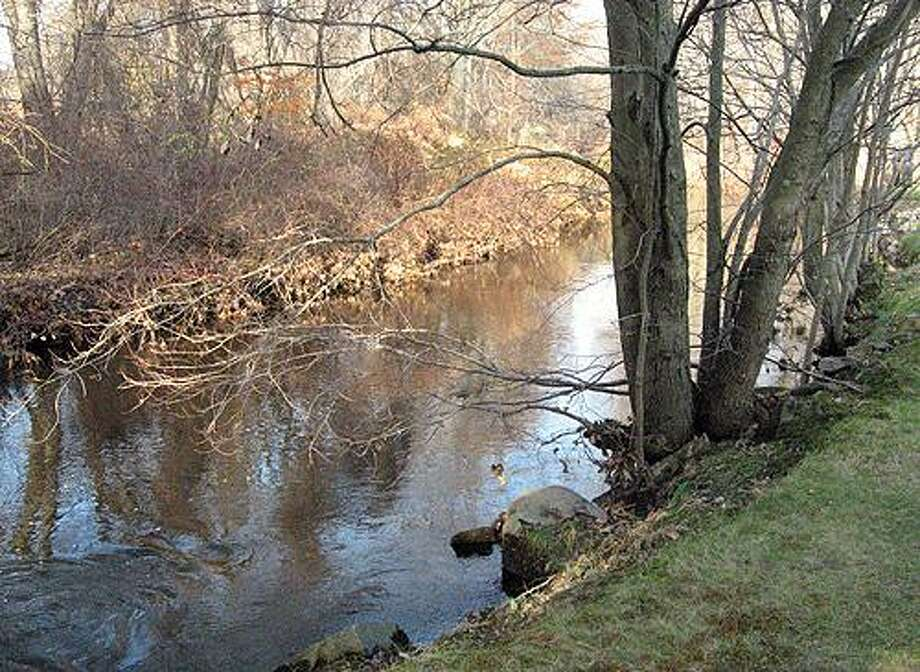 In this Nov. 19, 2010 photo, the Pequonnock River flows by the Chisholm home in Trumbull, Conn., where 21-month-old Tommy Chisholm slipped into the river on Nov. 17.  Chisholm was found barely alive two hours later and about 2 1/2 miles downstream in Bridgeport's Bunnell's Pond, and was declared dead later that evening at Bridgeport Hospital. (AP Photo/The Connecticut Post, John Burgeson) Photo: AP / Connecticut Post