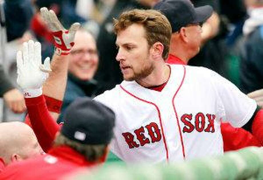 AP Boston's Jed Lowrie celebrates his two-run home run in the second inning of Saturday's game against the Toronto Blue Jays at Fenway Park in Boston. The Red Sox won 4-1.