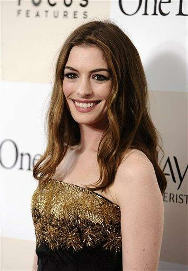 "Actress Anne Hathaway attends the premiere of ""One Day"" on Monday, Aug. 8, 2011 in New York. (AP Photo/Peter Kramer) Photo: AP / KRAPE"