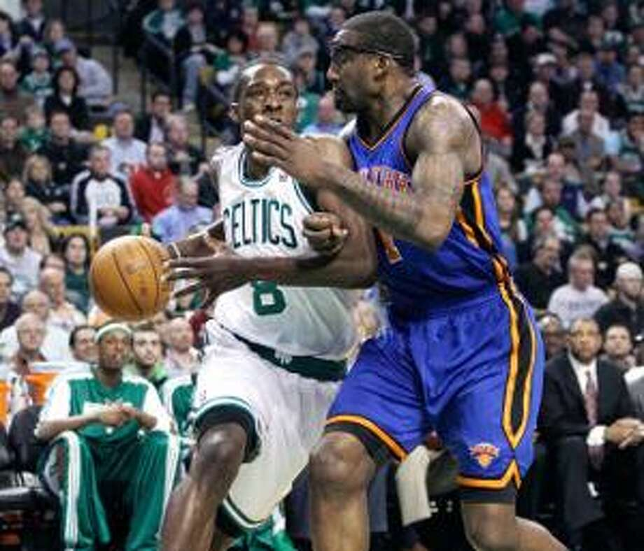 ASSOCIATED PRESS Boston Celtics forward Jeff Green, left, drives to the basket against New York Knicks forward Amare Stoudemire during the first quarter of an April 13 game in Boston. The Celtics face the Knicks in Game 1 of their playoff series tonight.