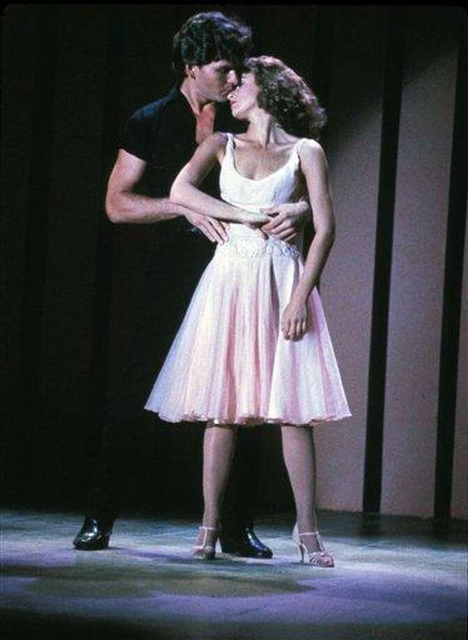 "FILE - In this image provided by Lionsgate Home Entertainment, Patrick Swayze, portraying Johnny Castle, and Jennifer Grey, portraying Baby Houseman, are shown in a scene from the film, ""Dirty Dancing."" Lionsgate is set to produce a remake of the film directed by Kenny Ortega. (AP Photo/Lionsgate Home Entertainment) Photo: AP / AP2008"