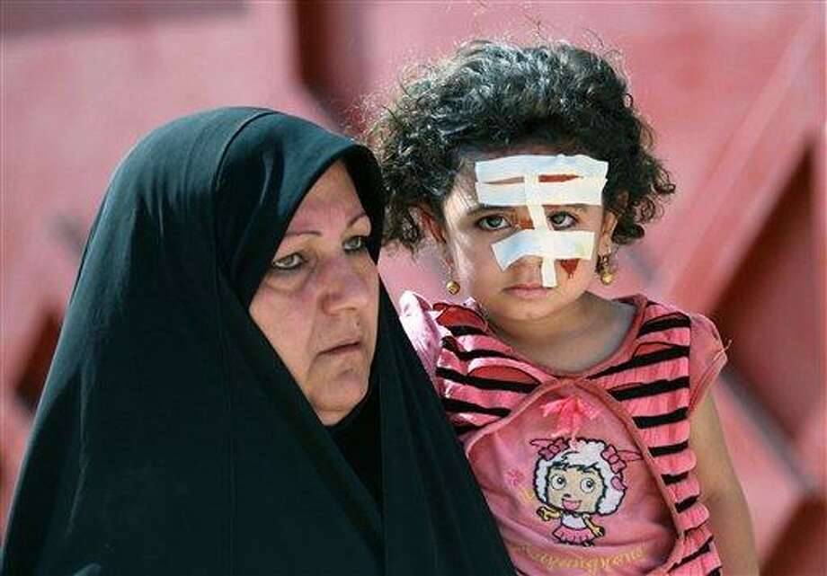 An Iraqi girl wears bandages after being injured in a bombing in Karbala, 50 miles (80 kilometers) south of Baghdad, Iraq, Wednesday, Aug. 25, 2010. A string of attacks targeting Iraqi security forces on Wednesday left several people dead and scores wounded, police and hospital officials said the day after the number of American soldiers in the country fell bellow 50,000.(AP Photo/Ahmed al-Husseini) Photo: AP / AP