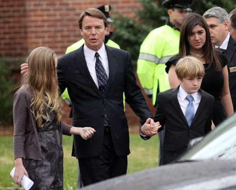 Former Democratic presidential candidate John Edwards and his children, Emma Claire, left, Jack and Cate, far right, leave the funeral service for Elizabeth Edwards at Edenton Street United Methodist Church in Raleigh, N.C., Saturday, Dec. 11, 2010. Edwards died Tuesday of cancer at the age of 61.  (AP Photo/Jim R. Bounds) Photo: ASSOCIATED PRESS / AP2010