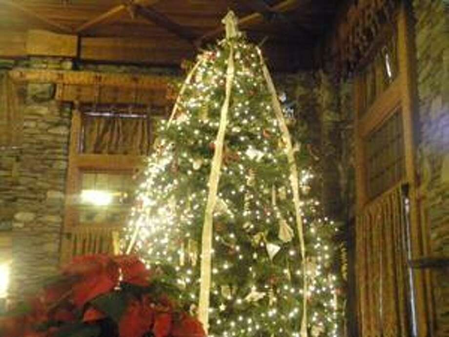 An authentic 18-foot Christmas tree transplanted from Macamoodus Park was erected inside Gillette Castle in East Haddam during last year's holiday celebrations. The museum, built between 1914 and 1919 by actor and playwright William Gillette, has 24 rooms decorated for the holidays. This year, the public can take tours on the weekends through Dec. 19.
