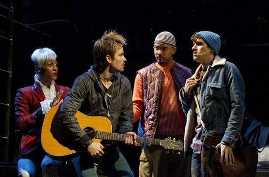 """In this theater publicity image released by Richard Kornberg & Associates, the cast of the Broadway production of """"Rent,"""" from left, MJ Rodriguez, Matt Shingledecker, Nicholas Christopher and Adam Chanler-Beratare are shown during a performance in New York. (AP Photo/Richard Kornberg & Associates, Joan Marcus) Photo: AP / ©2011 Joan Marcus"""