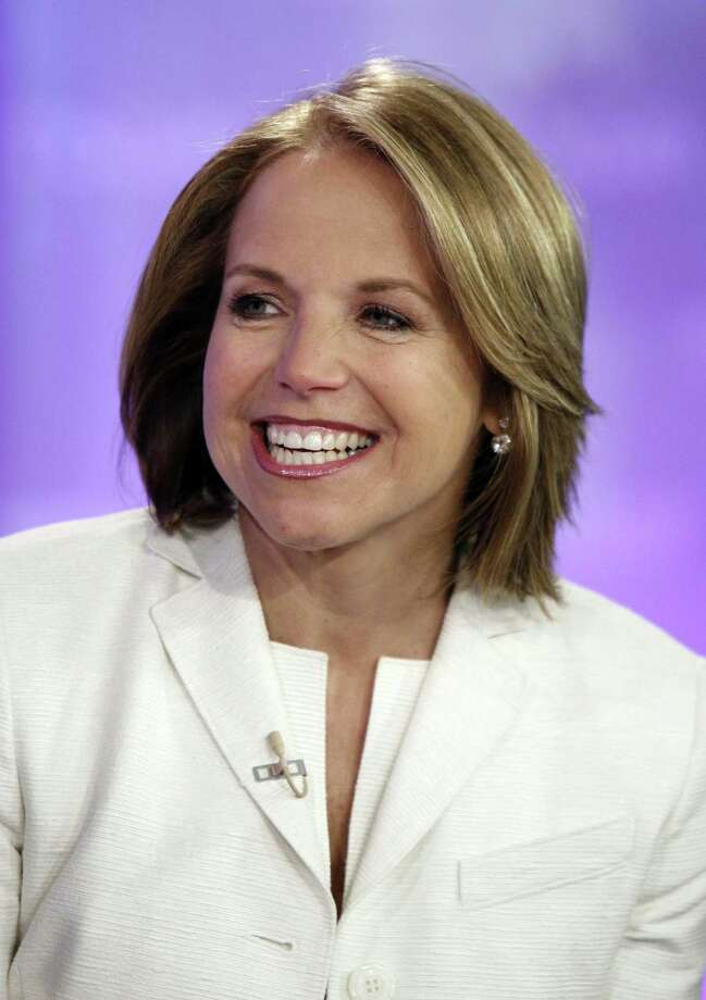 "In this May 28, 2008 photo, Katie Couric, anchor of the CBS ""Evening News,"" is interviewed on the NBC ""Today"" television program, in New York. In a return to her old ""Today"" show stomping grounds, Katie Couric says she expects to make a decision about her future in a few weeks.  The current ""CBS Evening News"" anchor and former ""Today"" host was interviewed Wednesday, by her former work partner, Matt Lauer, about a book she's just published and the questions about her future. Her CBS contract expires in June. (AP Photo/Richard Drew) Photo: AP / AP2008"