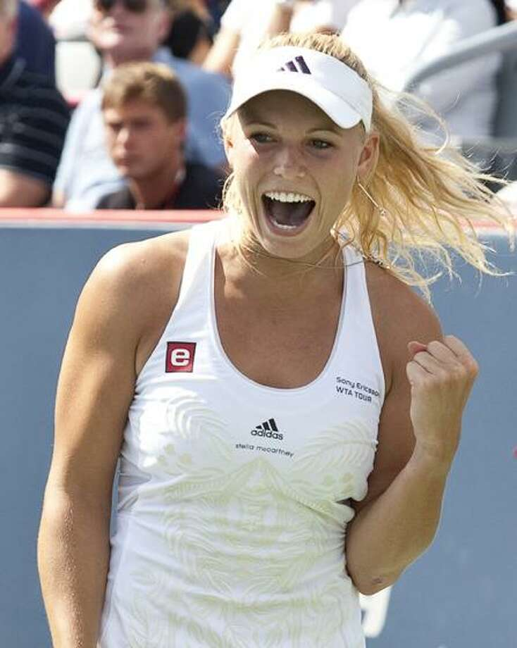 Caroline Wozniacki from Denmark celebrates after beating Vera Zvonareva from Russia in the final to win the Rogers Cup tennis tournament Monday, Aug. 23, in Montreal. Wozniacki is the No. 1 seed at the Pilot Pen Tennis Tournament in New Haven. (AP Photo/The Canadian Press,Paul Chiasson) Photo: AP / CP