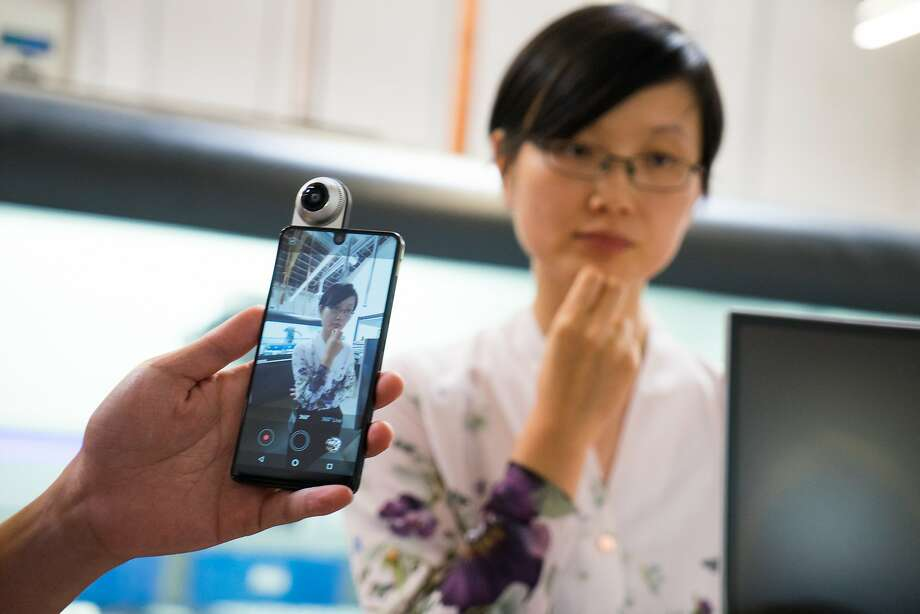 An engineer demonstrates the Essential smartphone's 360-degree video capabilities. Essential has released a phone that allows a 360-degree camera to be easily attached. Photo: James Tensuan, Special To The Chronicle