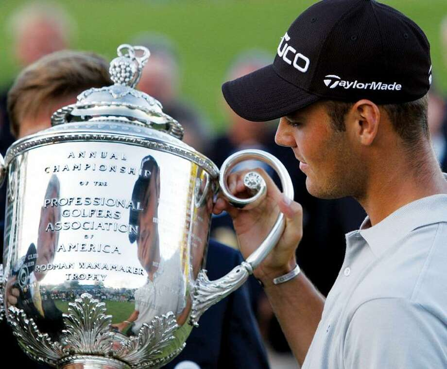 Martin Kaymer of Germany holds the Wanamaker Trophy after winning a playoff  against Bubba Watson at
