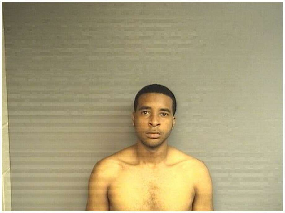 Caleb Newell, 22, of Stamford, was charged with criminal possession of a firearm following a raid on his East Side home Wednesday morning. Photo: Stamford Police / Contributed