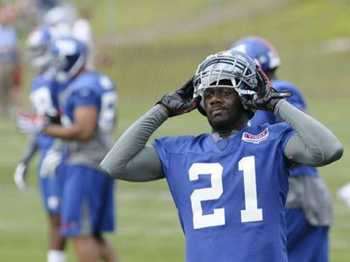 New York Giants' Kenny Phillips who is recovering from an injury watches teammates run drills on the first day of NFL football training camp in Albany, N.Y., Sunday, Aug. 1. (AP)