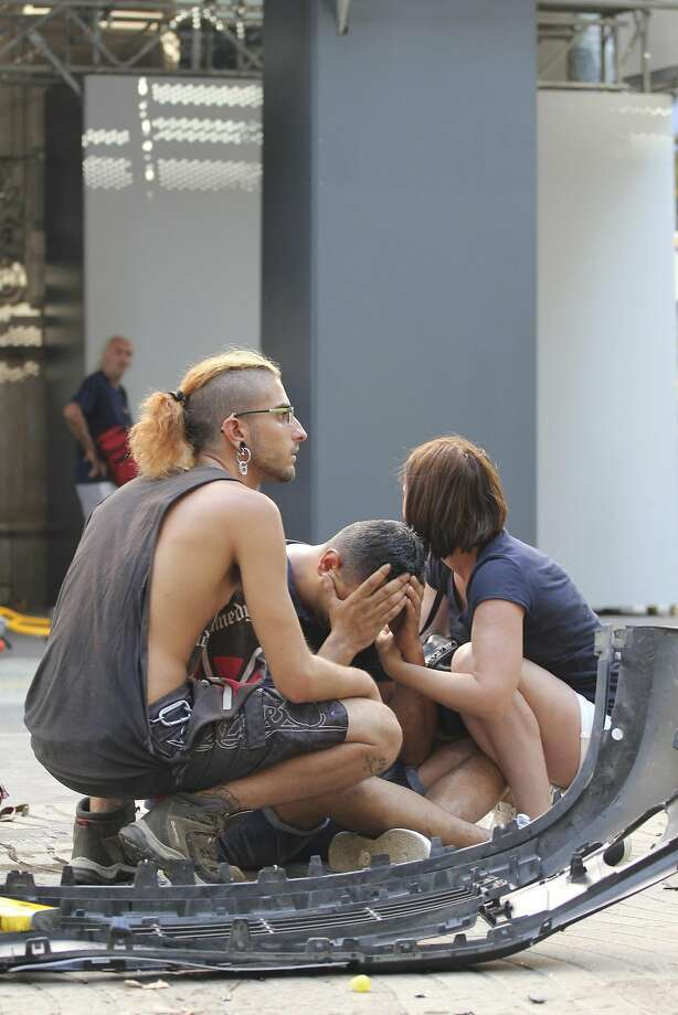 People react after what is being described as a terror attack. Photo: David Armengou/EFE, TNS
