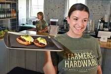 Julia Sanzen, co-owner and chef of Farmers Hardware restaurant delivers up an order of Eggs Shorty Wednesday August 9, 2017 in Saratoga Springs, NY.  (John Carl D'Annibale / Times Union)